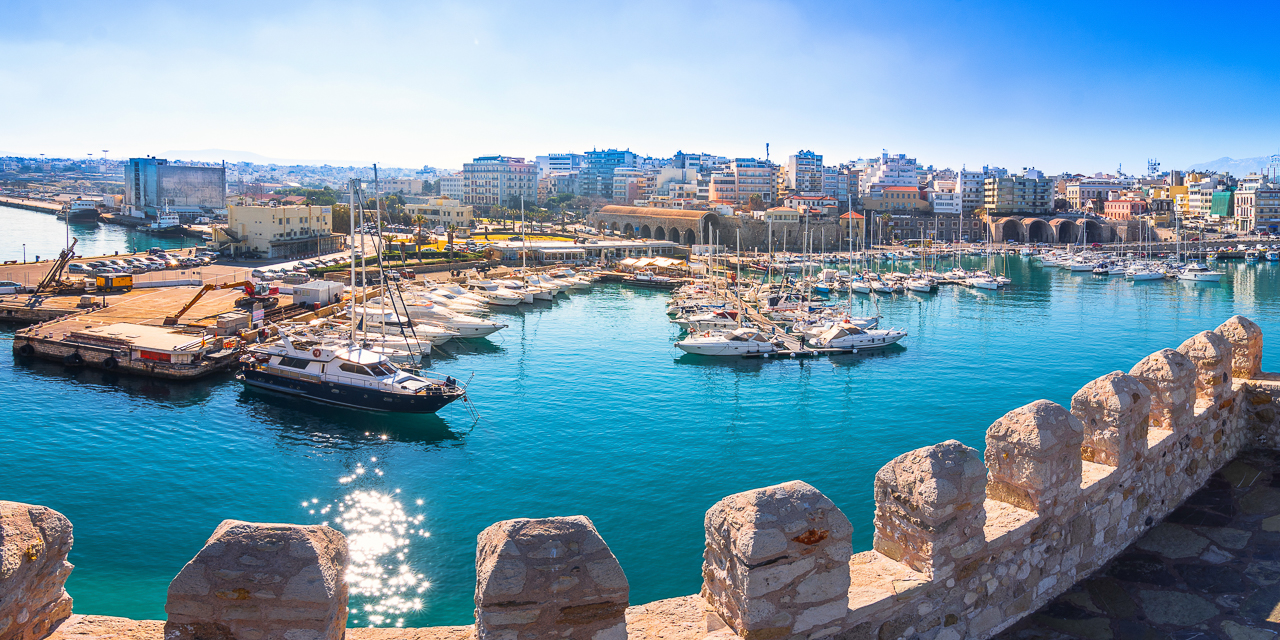 Heraklion harbour with old venetian fort Koule and shipyards, Cr